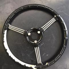 Steering wheels from 1950s Austin pedal car needing blast cleaning