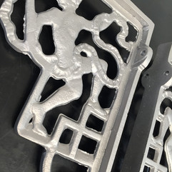 Ornate aluminium shelf brackets after vapour blasting