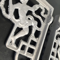 Ornate aluminium shelf brackets after vapour blasting