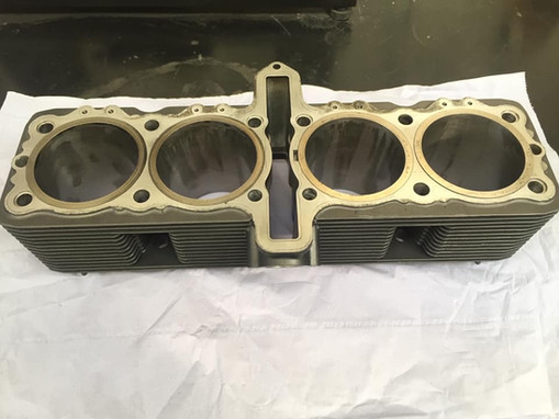 Suzuki cylinder and head deep cleaned in the Ultrasonic cleaner after having some porting work and cylinder honed