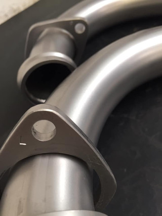 Vapour blasted motorcycle downpipes