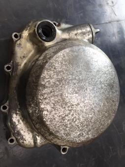 Honda CB500/4 engine side casings requiring vapour blasting