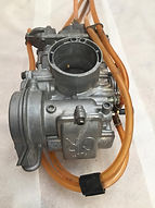 Ultrasonically cleaned carb
