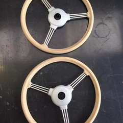 Steering wheels from 1950s Austin pedal cars blast cleaned ready for paint
