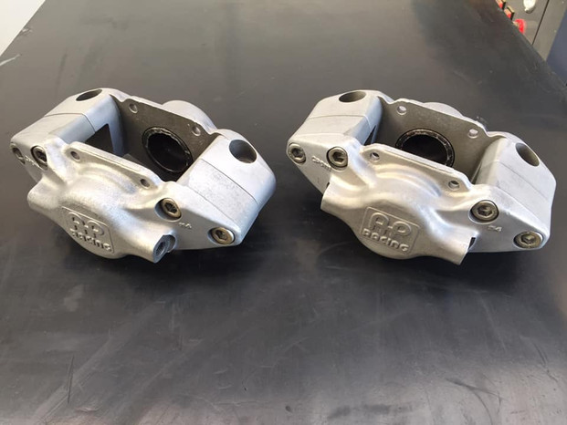 Front and rear AP racing brake calipers cleaned in the Vapour blast cabinet