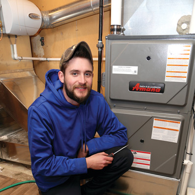 technician-next-to-furnace (1).jpg