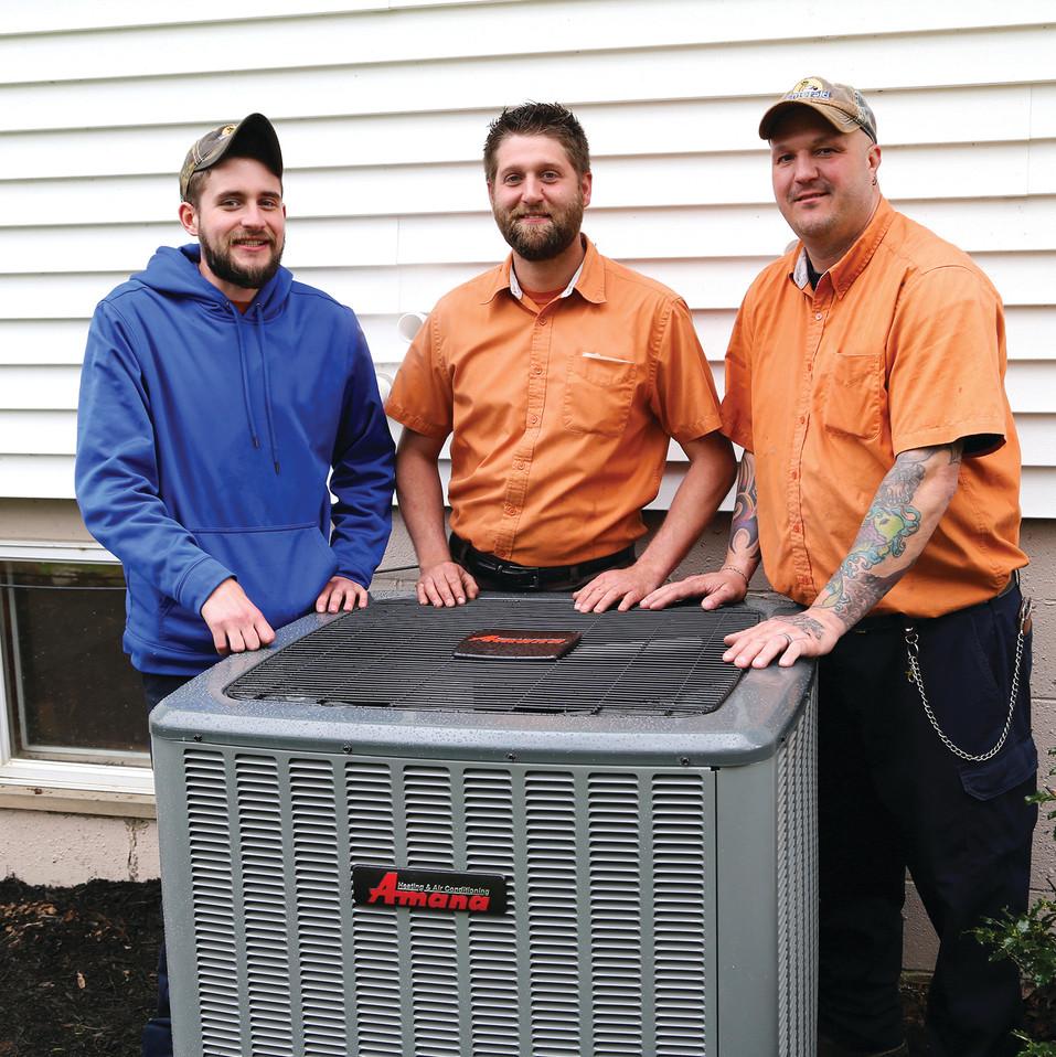 3-technicians-w-unit.jpg