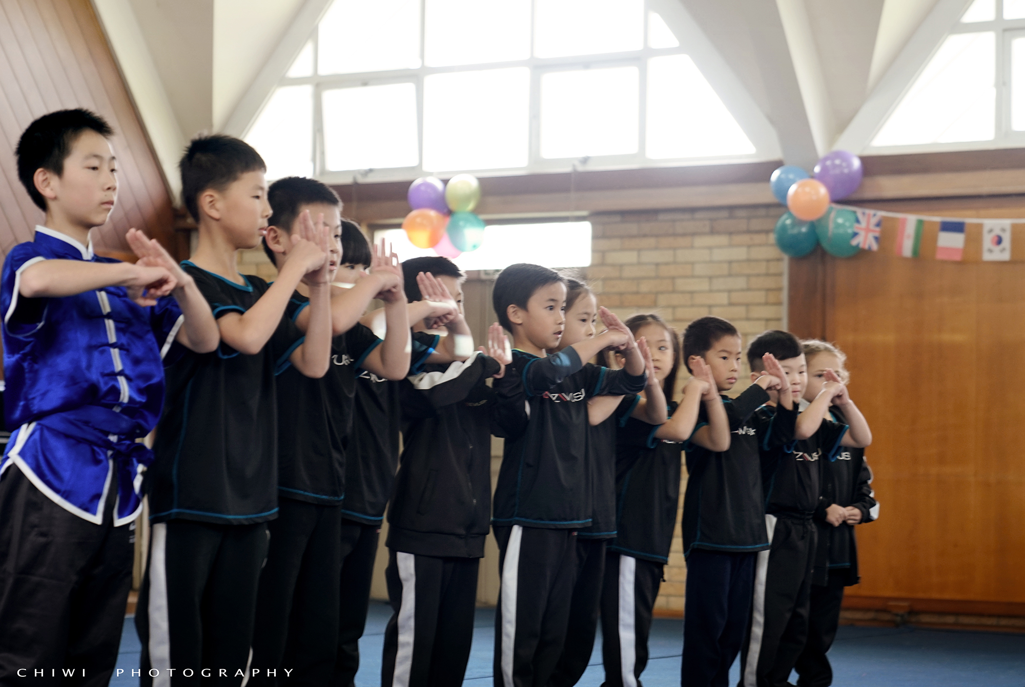 NZ Wushu Kids salute at end of performance
