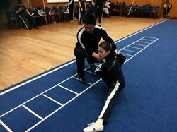 Teaching Anna pu bu crouching stance Nz Wushu