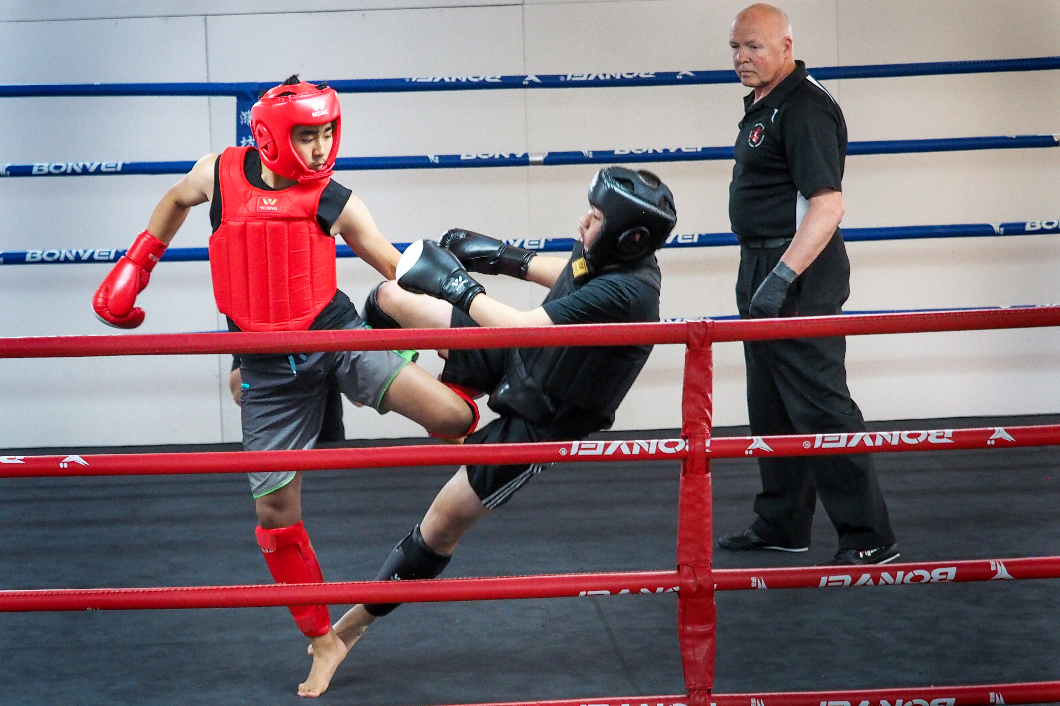 Sanda Kickboxing - Ryan Shen about to put his opponent down