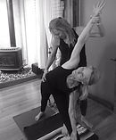 Cherie giving a student an adjustment triangle pose._