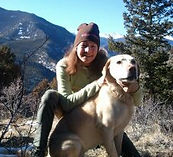 cherie and her dog Cassie in her backyard in the mountains.