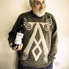 jumper with Ardbeg logo knitted on front modled by happy whisky enthusiast
