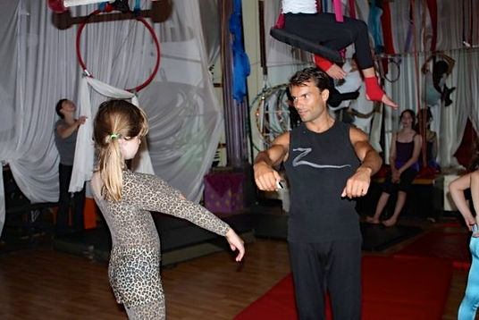 Stephan Choiniere with student at Le Petit Cirque