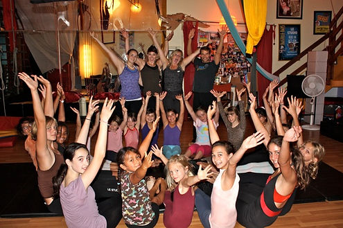 Stephan Choiniere with students at Le Petit Cirque