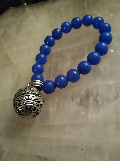blue crystal bracelet embellished with silver bell