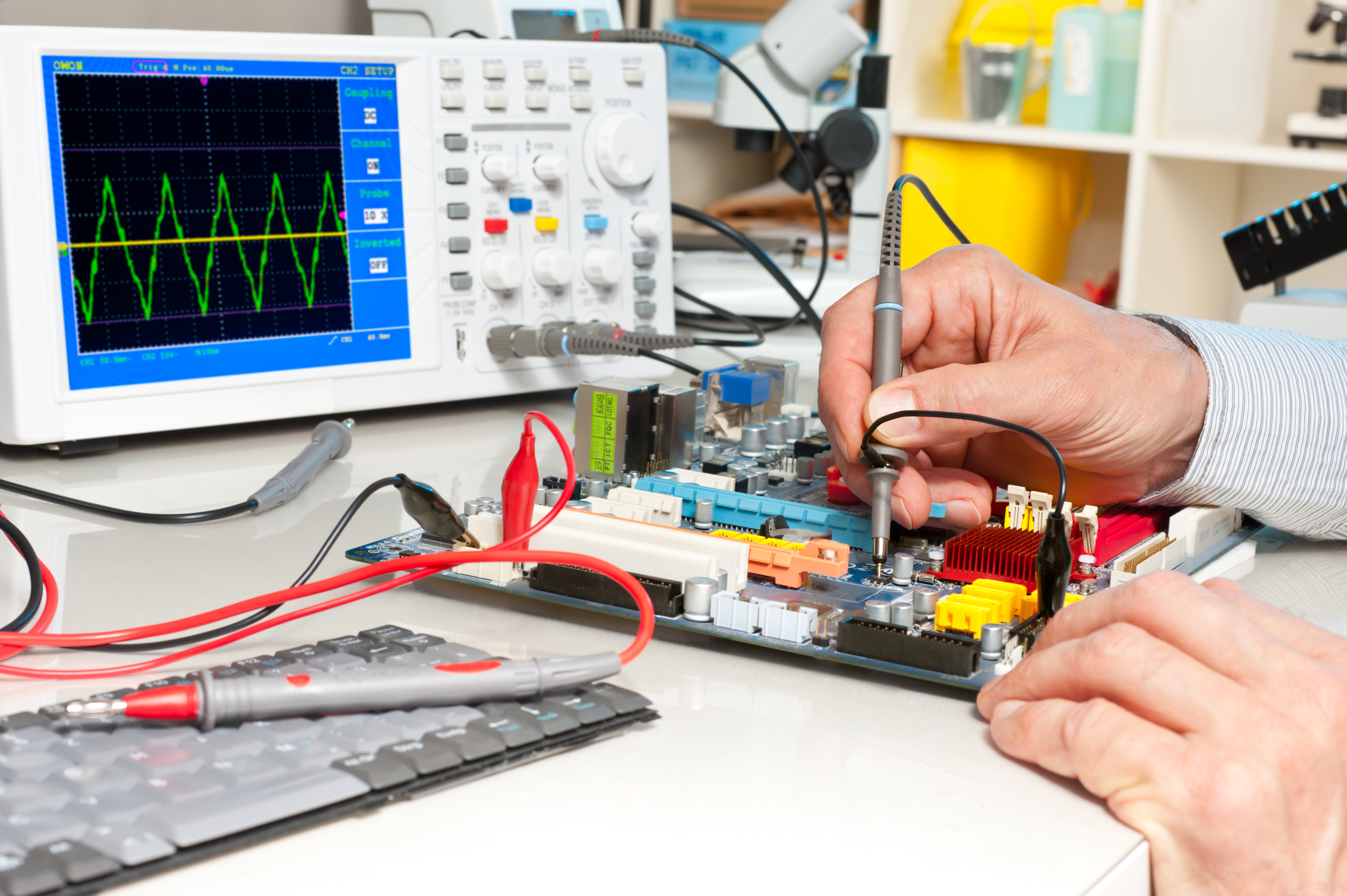 Tech tests electronic equipment in servi