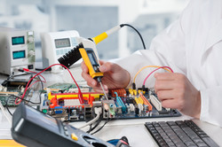 Repairman fixes electronic equipment in