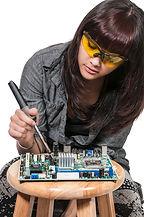 Beautiful woman repair soldering a print