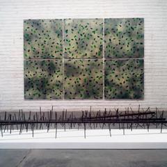 'Landscape Painting' (wall) Enamel acrylic spray-paint and vinyl on stainless steel; steel frames 200cm(h) x 300cm(w) 2017  'Crosswires' (floor) Mixed media on steel; wood 50cm(h) x 250cm(l) x 60cm(w) 2017