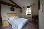 bedroom 2 with patio doors to garden