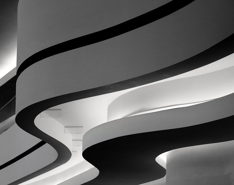 closeup-greyscale-shot-building-with-curvy-twists-berlin-germany.jpg