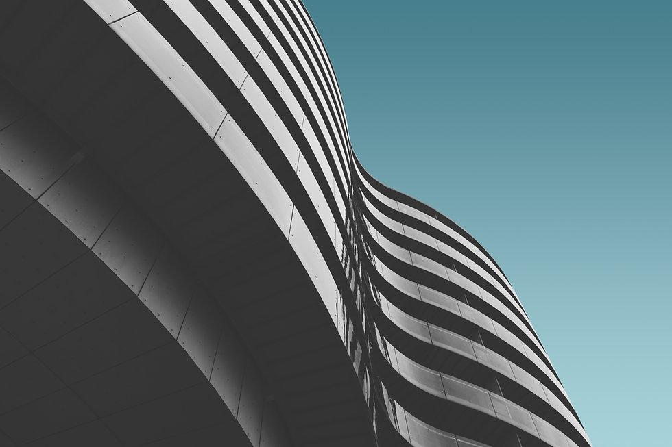 grey-concrete-building-blue-sky.jpg