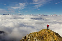 man-standing-on-mountain-against-sky-314