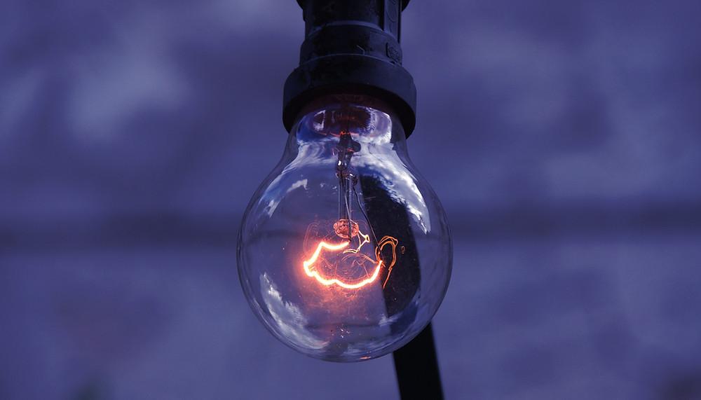 Illuminated lightbulb levitates in the air