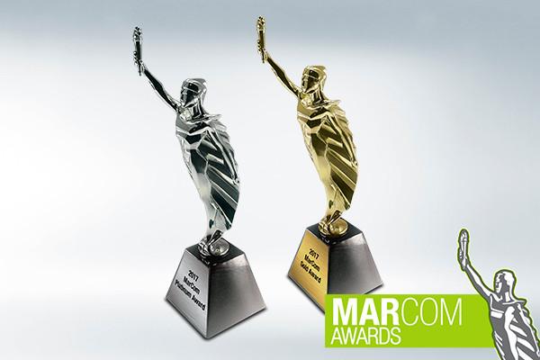 Platinum and Gold MarCom Awards on white background with MarCom logo