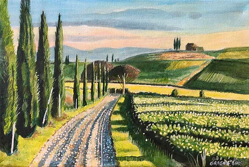 Tuscany path with cypresses on the left leading to a house on a hill on a sunny day
