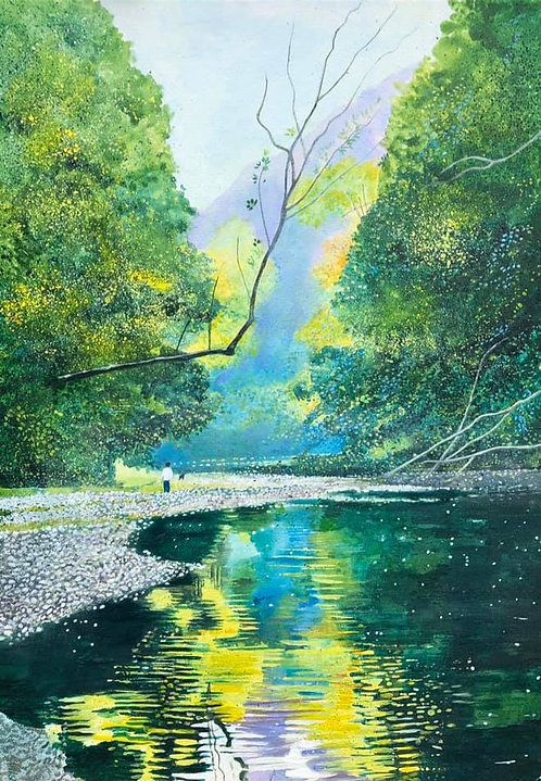 Lush green trees reflecting on a running fresh river, along which there is a stone path with a man and his dog having a walk
