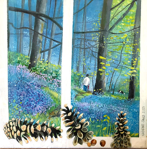 Through a white window you can see a man and his dog walking through a bluebell wood. Three pinecones at the window.