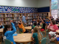 AUTHOR READING AND SPEAKING TO KIDS AT SCHOOL