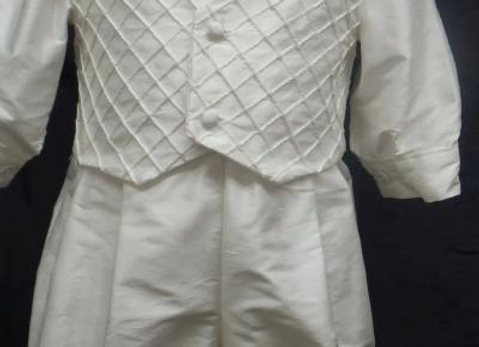 Handsome silk shantung romper with bow tie
