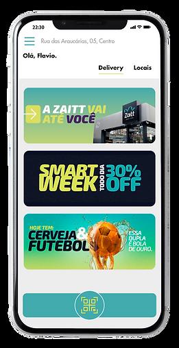Tela de smartphone mostra interface do app da Zaitt, com ofertas do momento, endereços de lojas autônomas e botão de QR code.