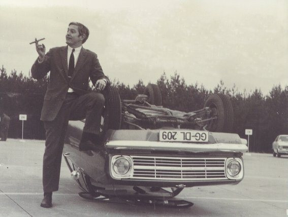 """Maximum"" Bob Lutz smoking a celebratory cigar after minimizing an Opel Kadett"