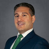 Headshot of John Apostolides, Investment partnet at Melody Investment Advisors