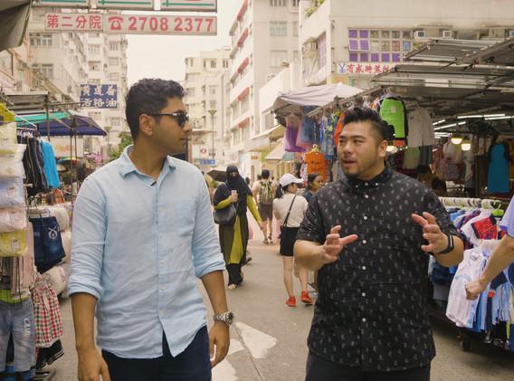 Sashi with Chef Christian Yang, walking through the busy neighborhood of Sham Shui Po