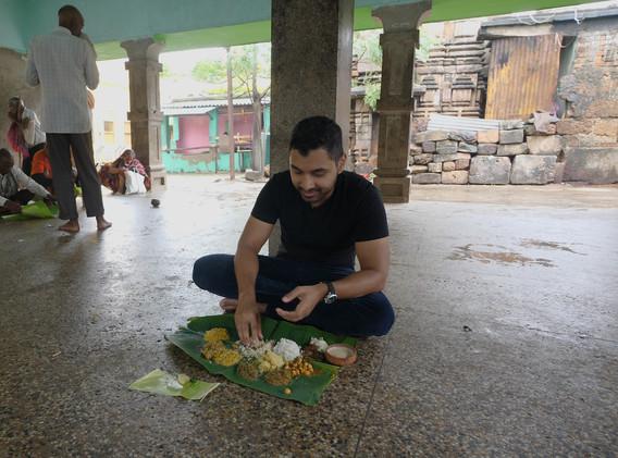 Sashi trying bhog, or temple food in Odisha