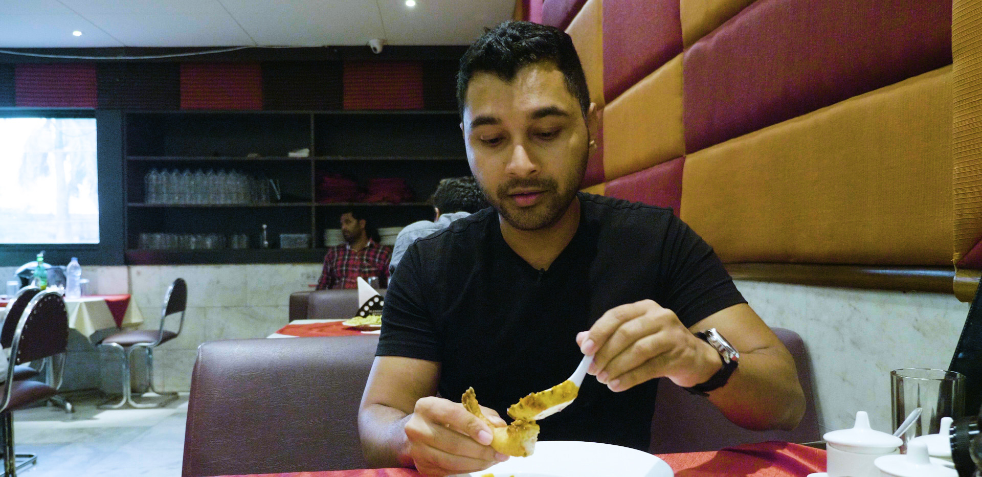 Sashi about to dig into a dish from Golden Joy, Kolkata
