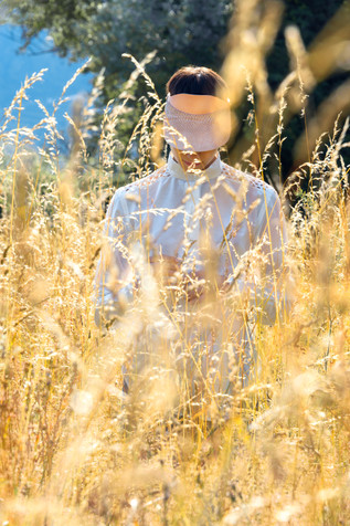 Agriculture; Crop; Diego Alborghetti; Field; Grass; Grass family; Grassland; Labels; Meadow; Outerwear; People in nature; Photography; Plant; Sunlight; Tree; Wildflower; Yellow