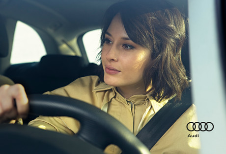 Audi; Auto part; Automotive design; Beauty; Black hair; Car; Car seat; Child; City car; Diego Alborghetti; Driving; Eye; Face; Family car; Head; Labels; Lip; Logos; Long hair; Luxury vehicle; Material property; Photography; Plant; Sitting; Smile; Steering part; Steering wheel; Vehicle; Vehicle door