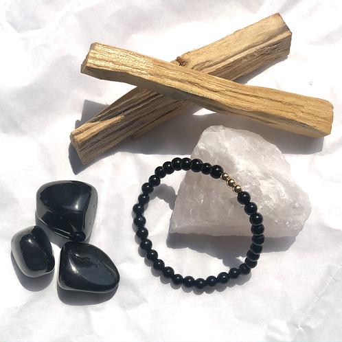 Black Onyx with three Gold Beads