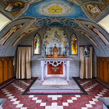 The inside of the chapel is so colorful and well crafted that you can't really believe that it was the work of prisoners.