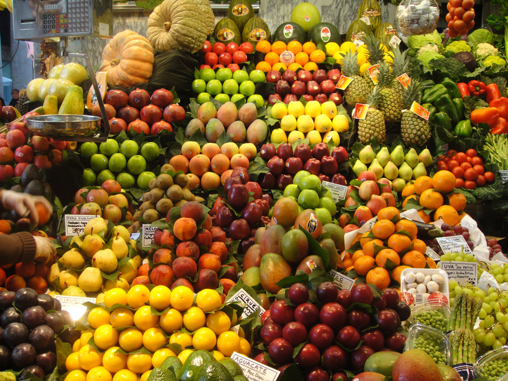 fruits and vegetables on a stand in a store