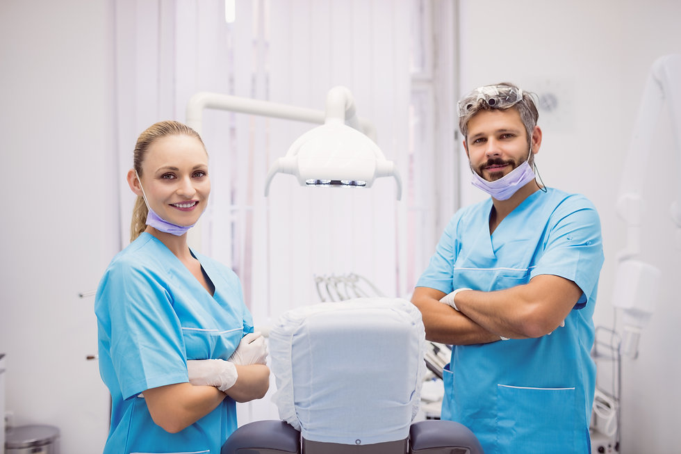 dentist-standing-with-arms-crossed-at-dental-clinic.jpg