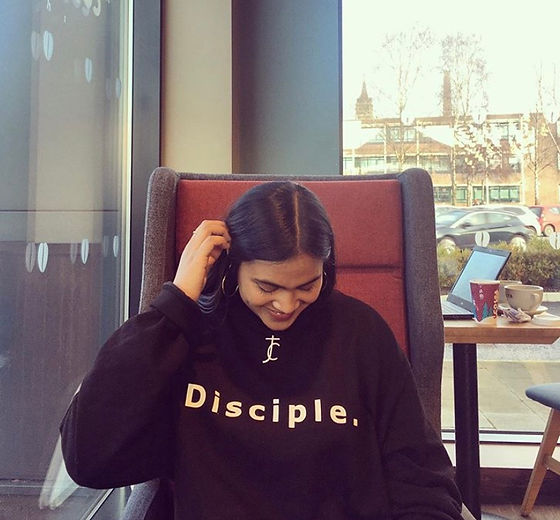 Susanna wearing our Disciple Sweater