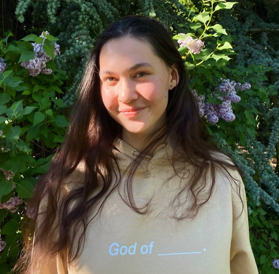 Emily wearing our God of __ Hoodie.png