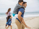 A family enjoying a beautiful day at Nosara beach Costa Rica